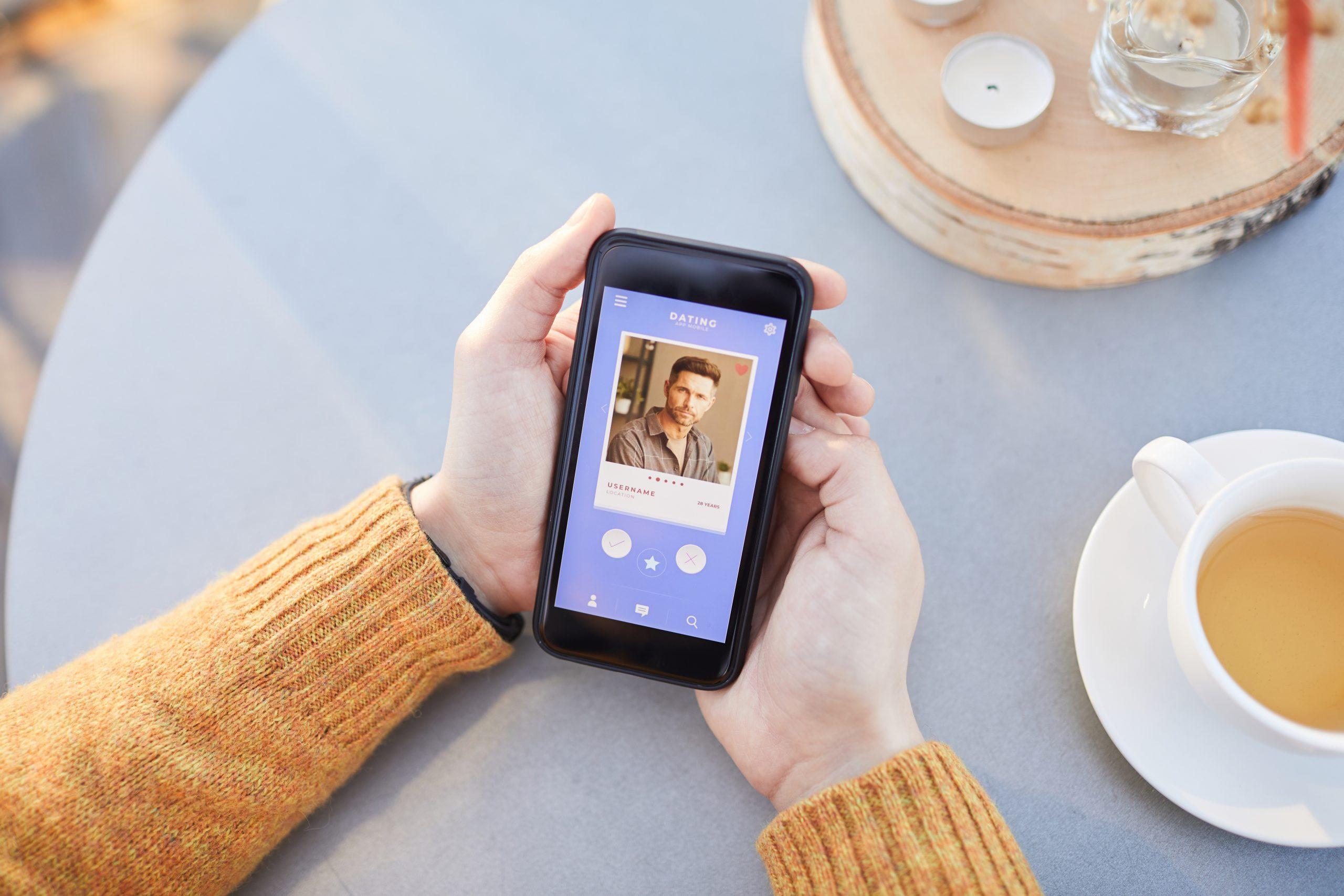 girls hand swiping an online dating app